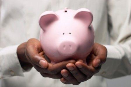 piggy bank in hands