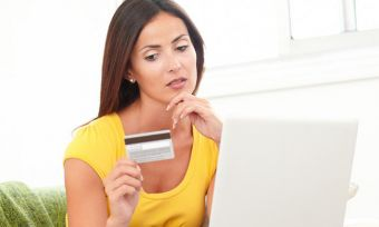 Woman thinking credit card