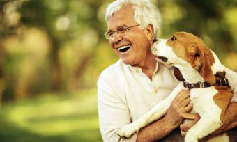 Ageing man with beagle dog