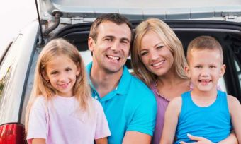 Family in the back of a car