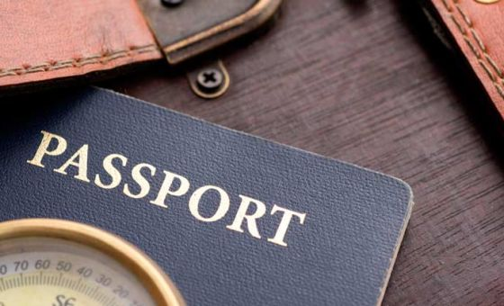 Passport, Compass and Leather Bag