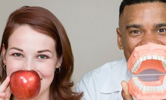 Man and woman with apple and teeth