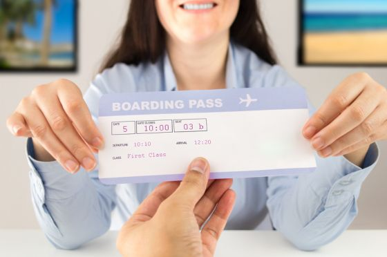 travel agent delivering flight ticket to customer