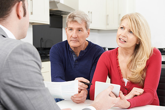 Old couple with financial advisor