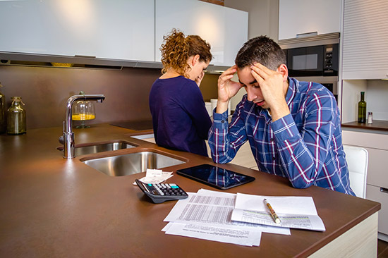 Worried Couple in Kitchen